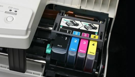Qual a diferen�a entre impressora a laser e a jato de tinta?